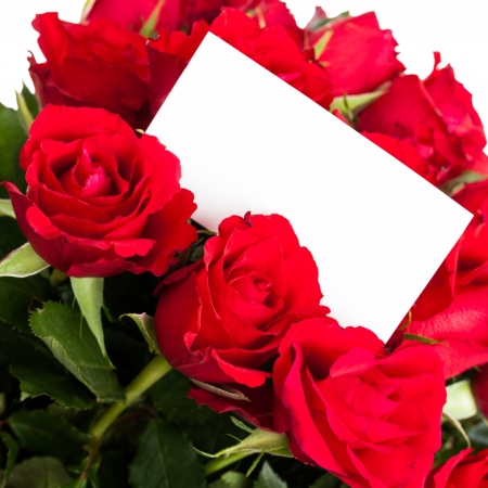 A bouquet of red roses with a blank gift tag. photo