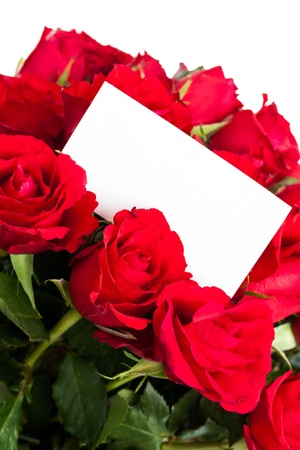 Red roses with a blank gift tag