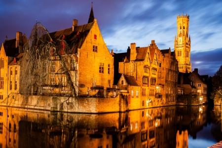 Rozenhoedkaai  and  Belfry  in Bruges  Belgium