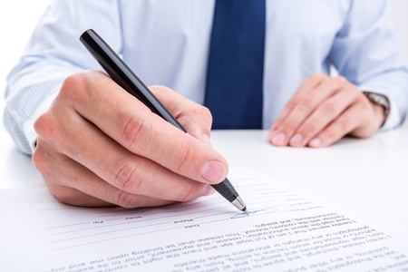 bank manager: Businessman signing a document  Stock Photo