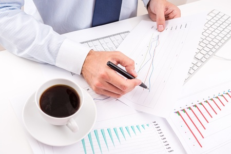 Businessman analyzing charts photo
