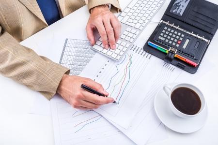 Businessman analyzing charts photo