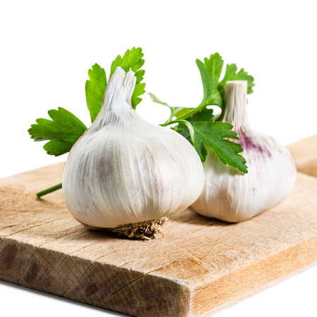 Garlic and Parsley on Wooden Cutting Board  Stock Photo