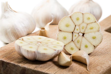 garlic cloves: Bulbs of fresh garlic with several cloves  Shallow depth of field