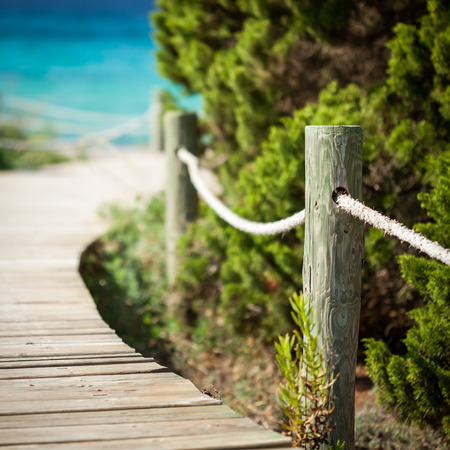 Wooden path leading to the beach  Formentera island  Spain