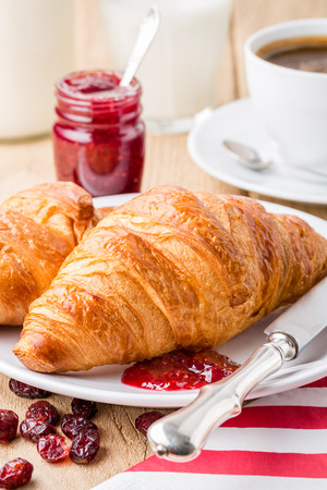 French breakfast  Croissants with raspberry jam and coffee  Shallow depth of field