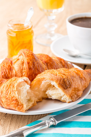 traditionally french: French breakfast  Croissants with orange jam and coffee  Shallow depth of field
