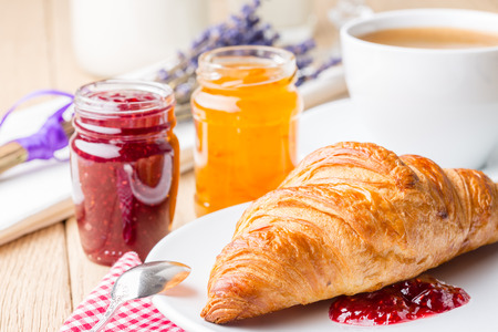 French breakfast  Croissants with raspberry and orange jam  Shallow depth of field  Standard-Bild