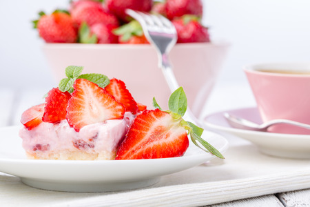Strawberry cake with coffee or tea