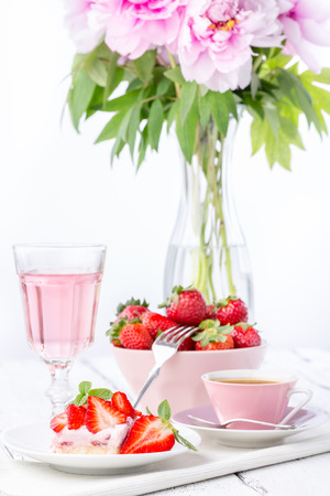 Strawberry cake with coffee or tea and pink lemonade   rose wine
