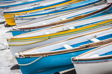 Colorful wooden boats at Marina Grande harbor, Island of Capri, Italy  photo