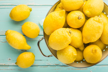 organic lemon: Fresh lemons in retro colander