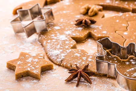 Making Christmas gingerbread cookies. Shallow depth of field. photo