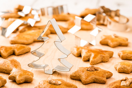 Christmas gingerbread cookies with cutter. Shallow depth of field.