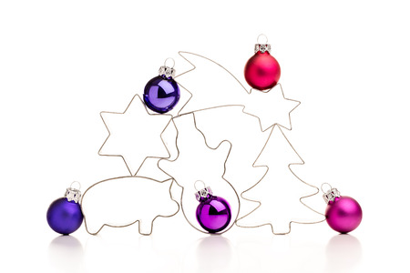 Colorful christmas baubles and gingerbread cookie cutters.
