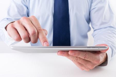 Businessman using a digital tablet.