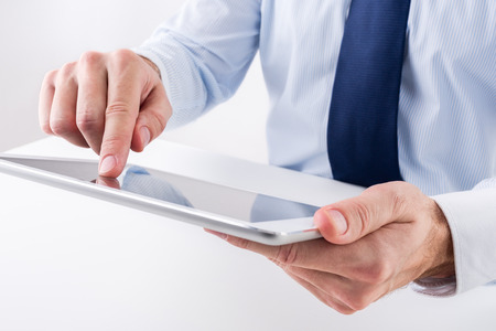 pointing device: Businessman using a digital tablet.