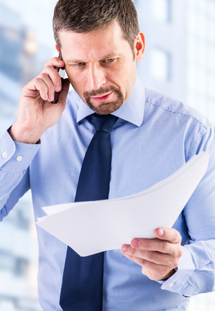 Young businessman making a phone call. Stock Photo
