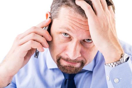 Stressed businessman making a phone call. Standard-Bild