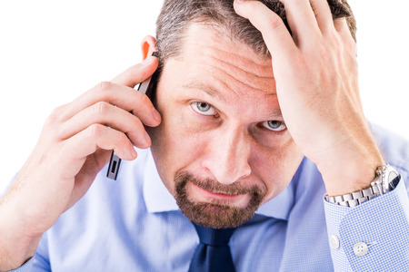 Stressed businessman making a phone call. Stock Photo
