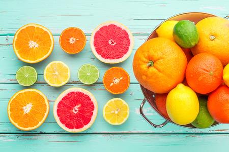Citrus fruits in retro colander.