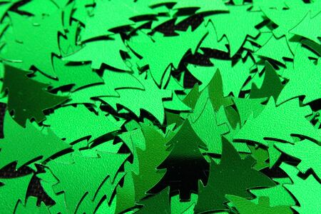dispersed: green christmas tree ornaments dispersed close-up Stock Photo