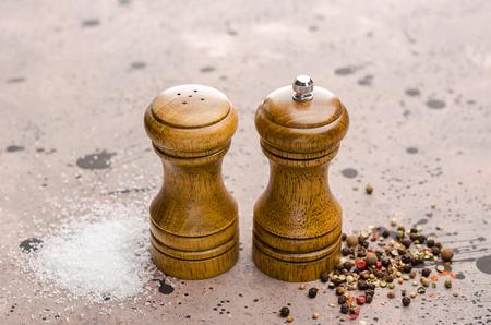 Wooden salt and pepper shaker. Seasoning salt and pepper on the table.