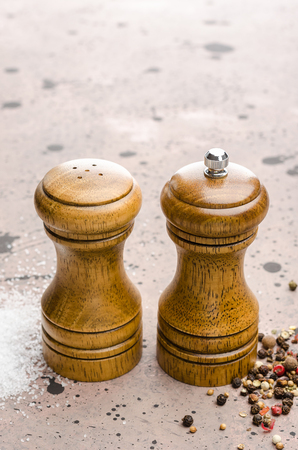 Wooden salt and pepper shaker. Seasoning salt and pepper on the table. 스톡 콘텐츠 - 119438987
