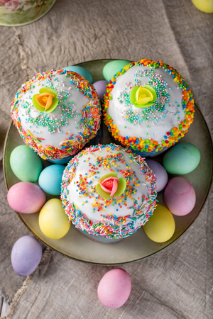 Easter still life. Easter cake, painted eggs with tulips on a wooden old rustic background. Stock Photo