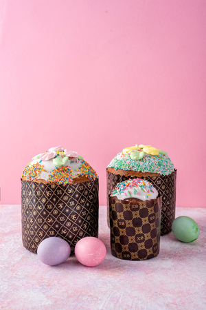 Easter still life. Easter cake, painted eggs pink background. Minimalism.