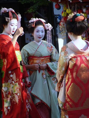 3 trainee geisha taking a break