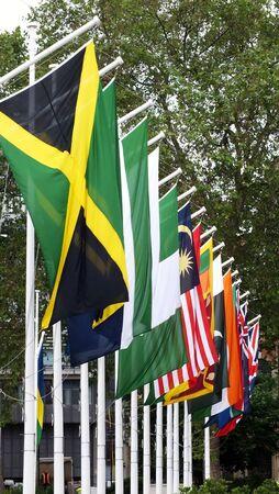 Row of flags on flag poles Stock Photo - 14004441