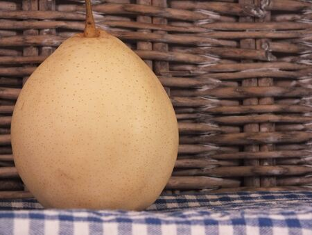 asian pear: Asian Pear with picnic basket and checked table cloth
