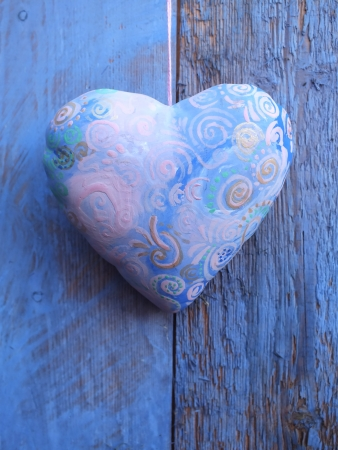 panelled: Ceramic heart on a panelled blue painted rough wooden door