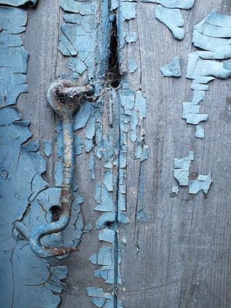 grungey: Ancient blue door latch on blue grungey door