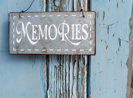 Shabby chic Metal memories sign on blue grunge background photo