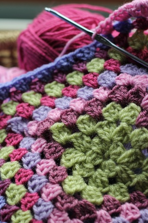 Vintage feel crochet, the making of an afghan blanket, with wool in a basket photo