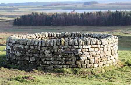 Sixteenth century well at Housesteads Roman Fort on Hadrian s Wall, Northumberland, UK photo