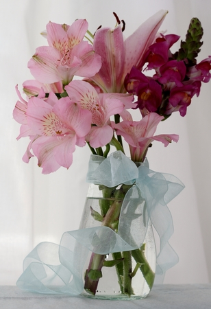 organza: Glass jar of pretty pink flowers , white muslin curtains and organza blue bow, alstromeria, lily and snapdragons, wedding decoration, birthday or mother s day gift