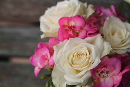 Pretty, small posy of cream roses and pink fuchsia , tied bouquet for wedding decoration or gift, shabby chic  photo