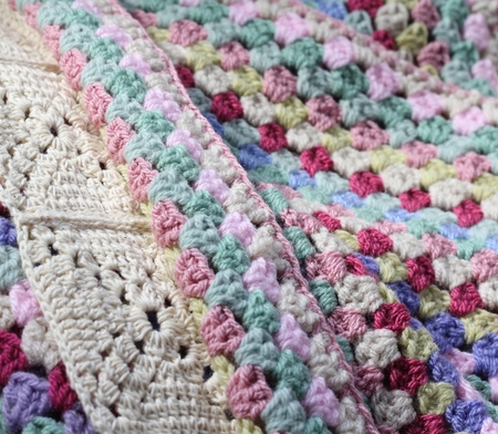 pinks: A pretty handmade crochet afghan wool blanket , details of different stitch types, vintage shades of creams, pinks, blues and green yarns, a craft and hobby