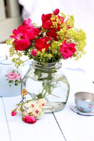 alchemilla: Summer tea party, glass jar of wild flowers, toy tin tea pot and cup and saucer