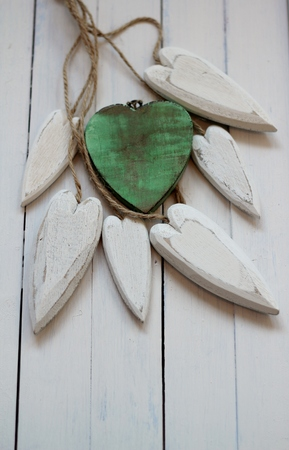 floorboards: Wooden green and white  hearts on white painted wooden floorboards. Simple, shabby chic image, valentine, wedding , romantic