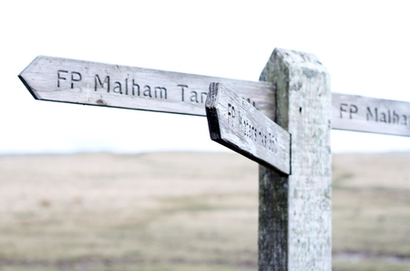 sign post: Wooden sign post on moors at Malham Cove, Yorkshire, UK