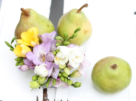english pear and freesia on a white wooden crate , unusual wedding table decoration