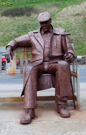 SCARBOROUGH UK APRIL 1st 2017. Statue by Ray Lonsdale Freddie Gilroy and the Belsen Stragglers inspired by a miner who fought in WW2,   bought for the town by a local resident