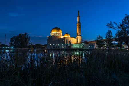 Puchong Mosque scenery during sunrise, blue hour, reflection