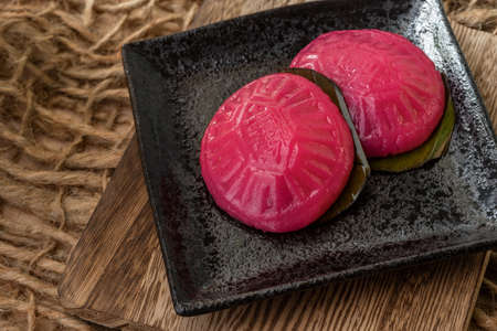 Asian Nyonya Food - kuih angku (Red Tortoise Cake traditional cake made of glutinous rice flour with red bean paste filling)