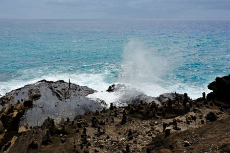 Active Halona blowhole spewing water