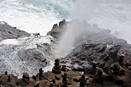 View from lookout over blowhole spewing water